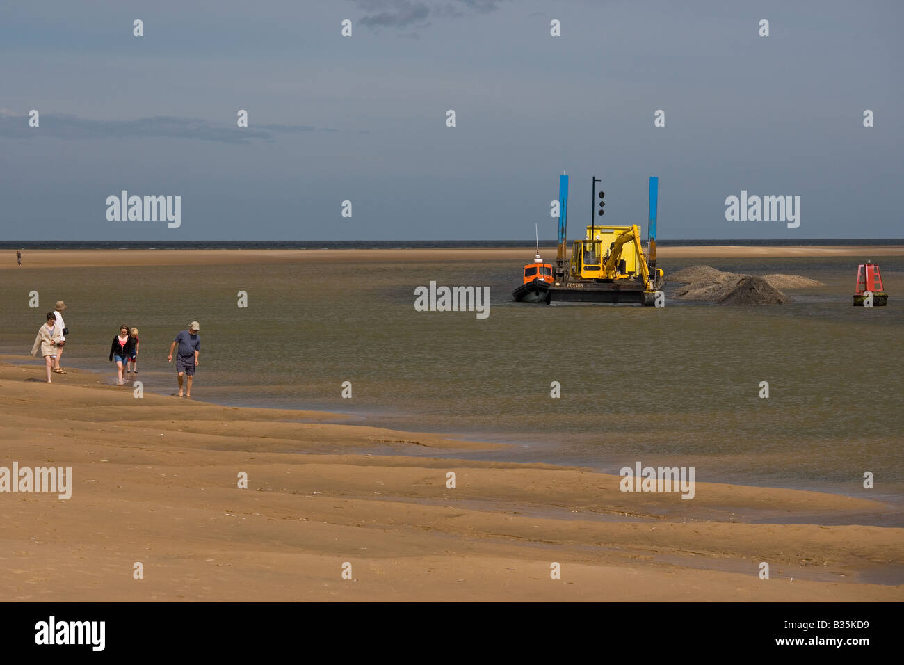 Wells-next-the-Sea a port on the North Norfolk coast of England.Autumn dredger at work Stock Photo
