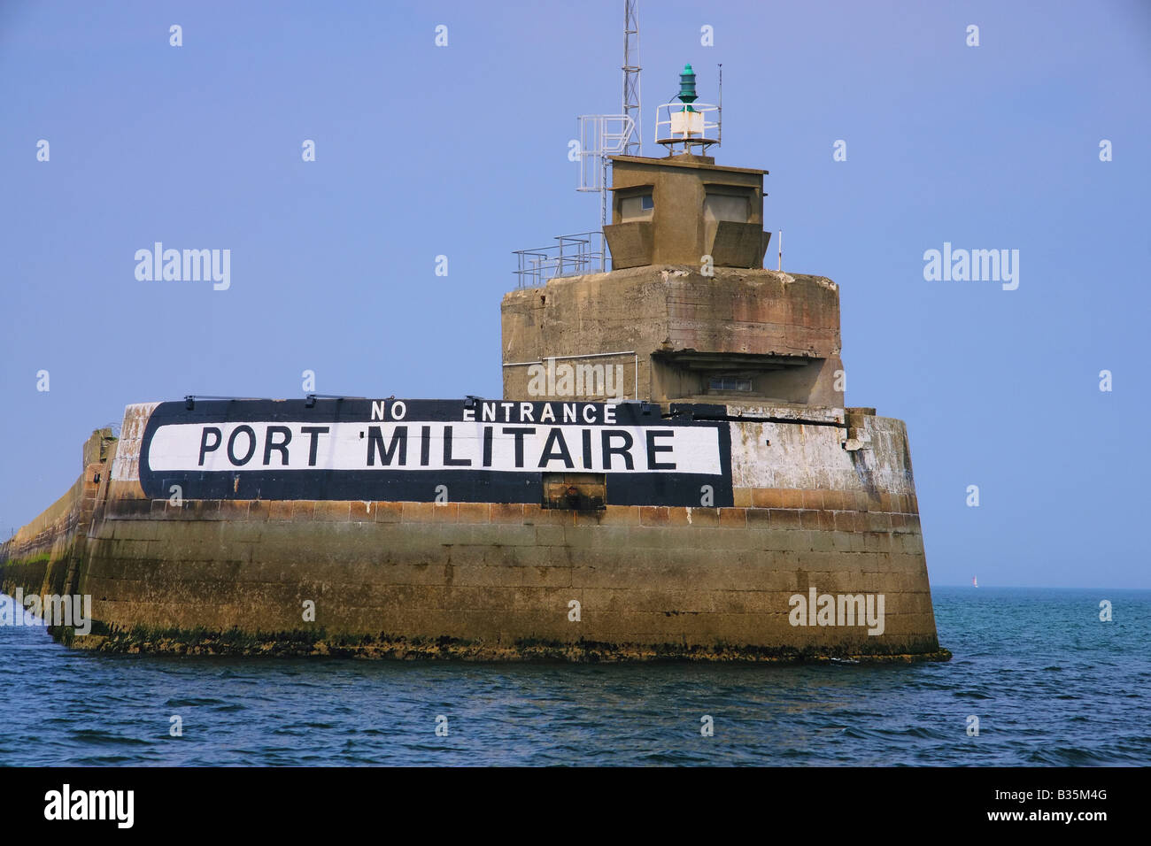 A breakwater with a guard post and 'no entrance - port militaire' [Military port] in the Cherbourg port, - Stock Image