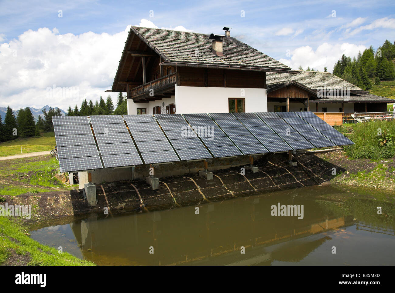 Solar panels outside a house - Stock Image