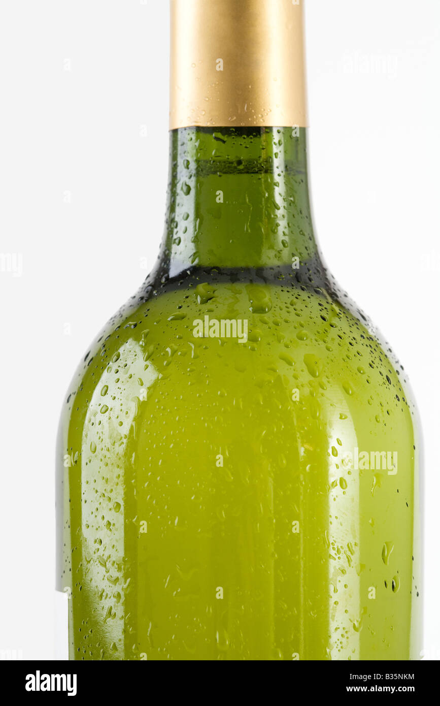 Bottle of white wine covered with drops of water, cropped - Stock Image