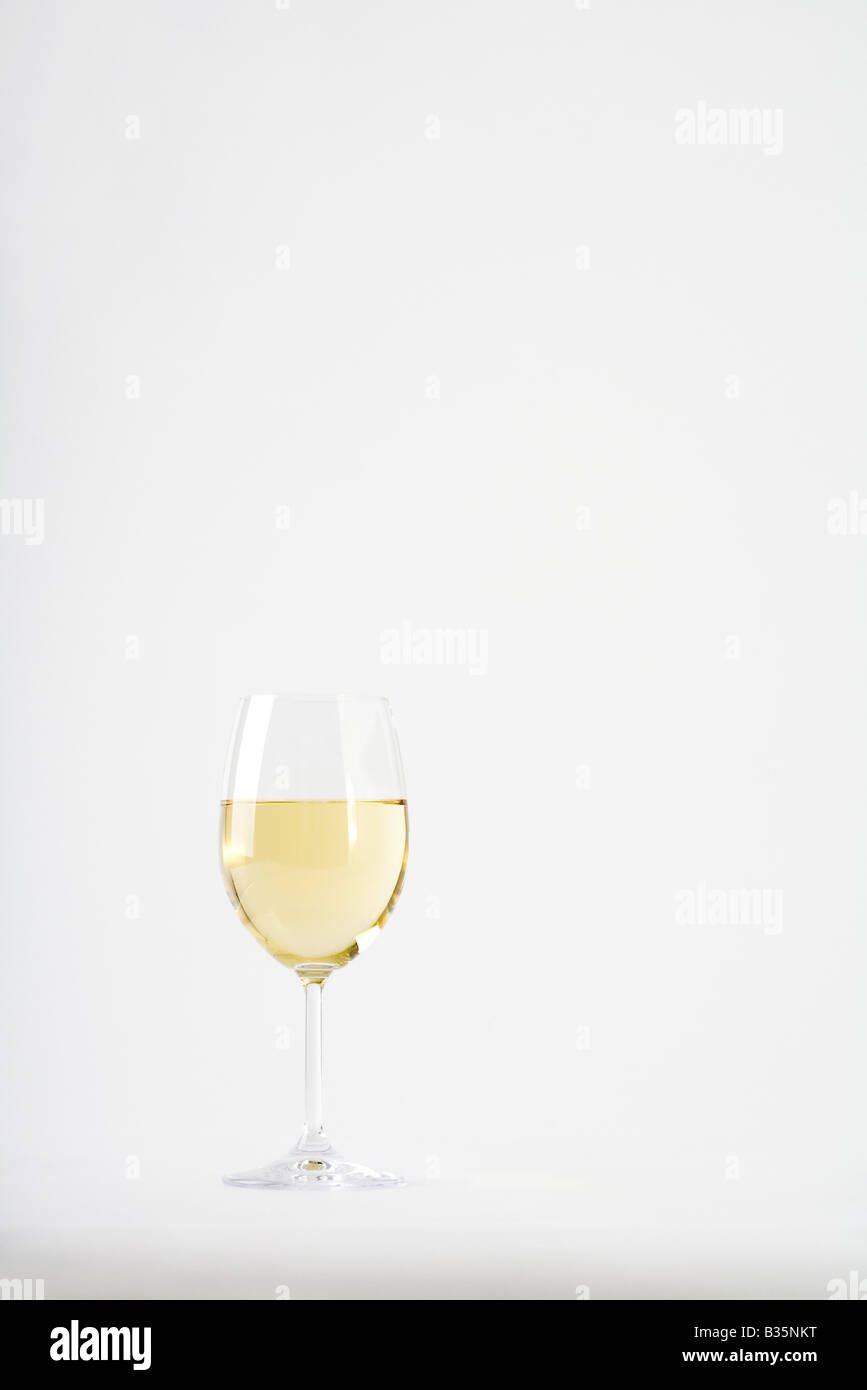 Glass of white wine - Stock Image