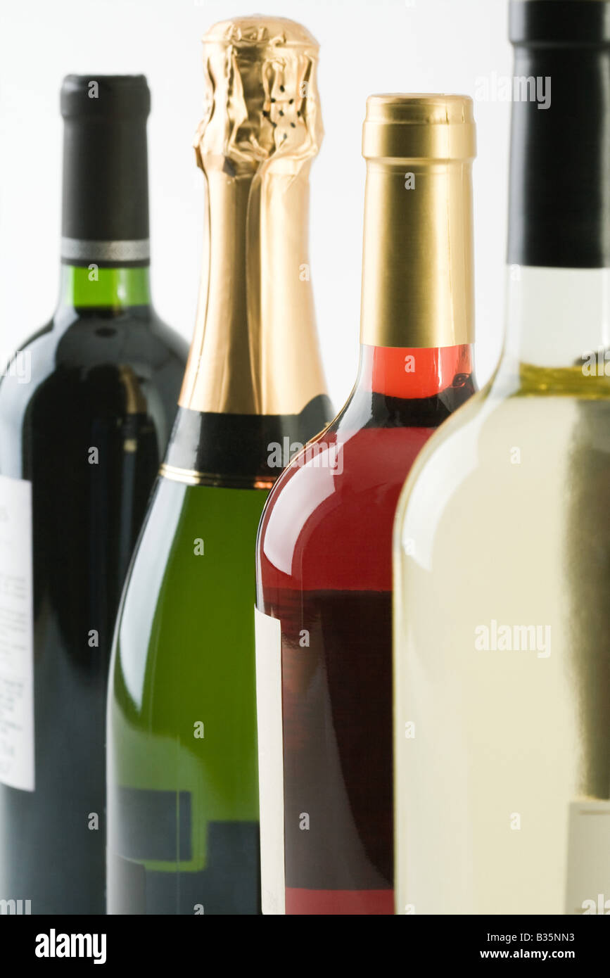 Assorted wine bottles, close-up - Stock Image