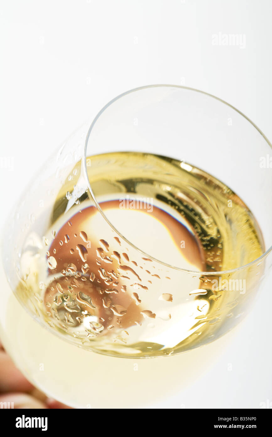 Glass of chilled white wine, close-up, high angle view - Stock Image
