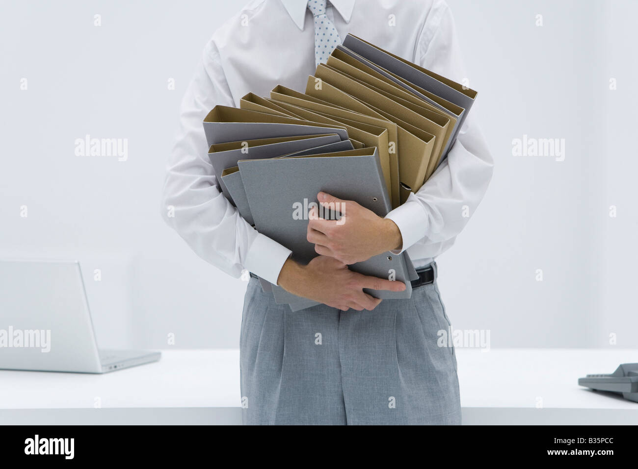 Man holding many binders, cropped view - Stock Image
