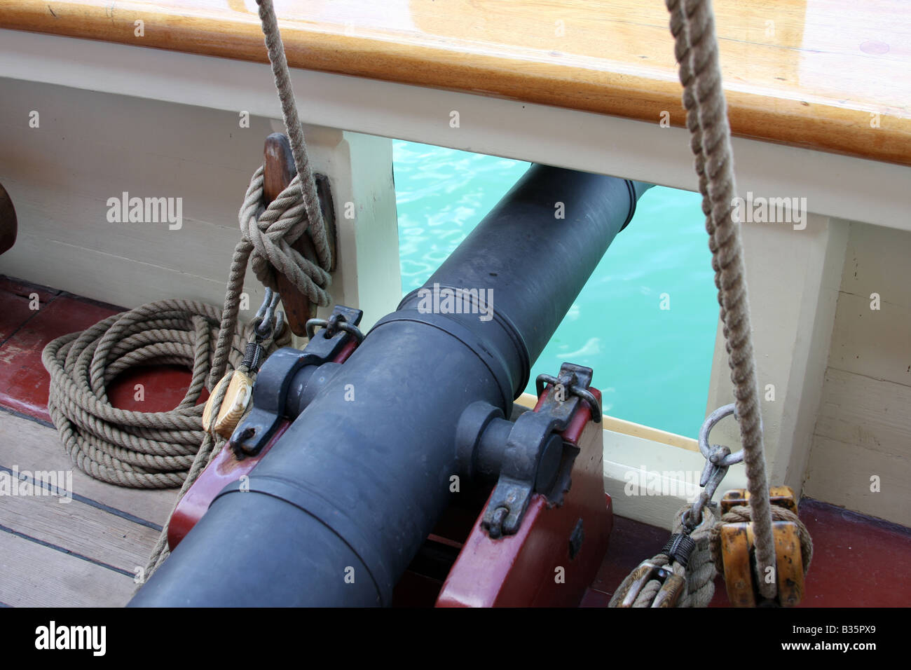 A cannon on the deck of the Pride of Baltimore ship at the Maritime Festiville in Port Washington Wisconsin - Stock Image