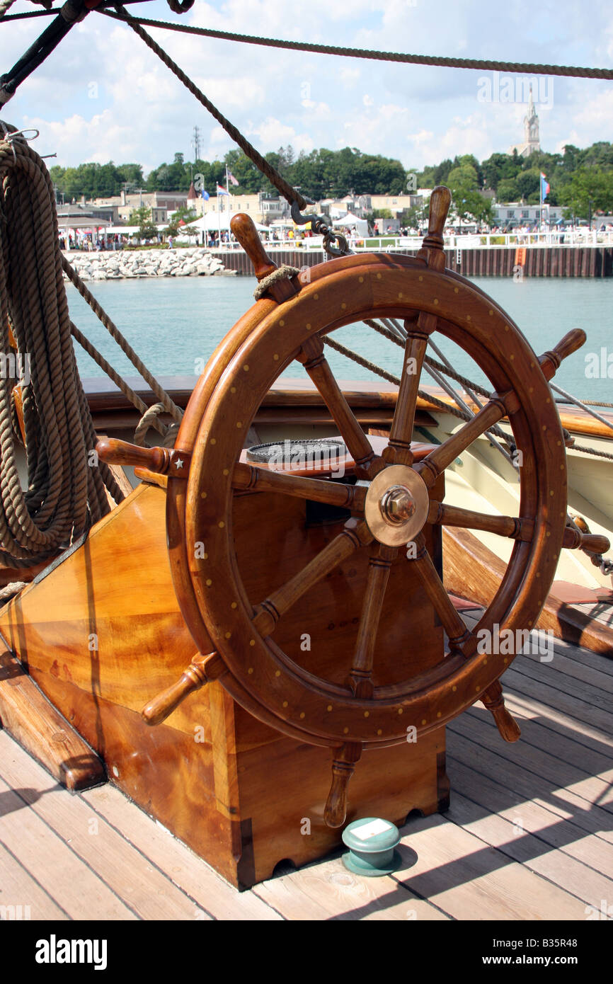 The steering wheel on the Pride of the Baltimore Ship at the Maritime Festiville in Port Washington Wisconsin - Stock Image