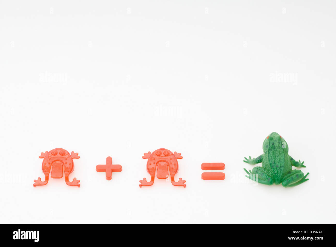 Red frog plus red frog equals green toad - Stock Image