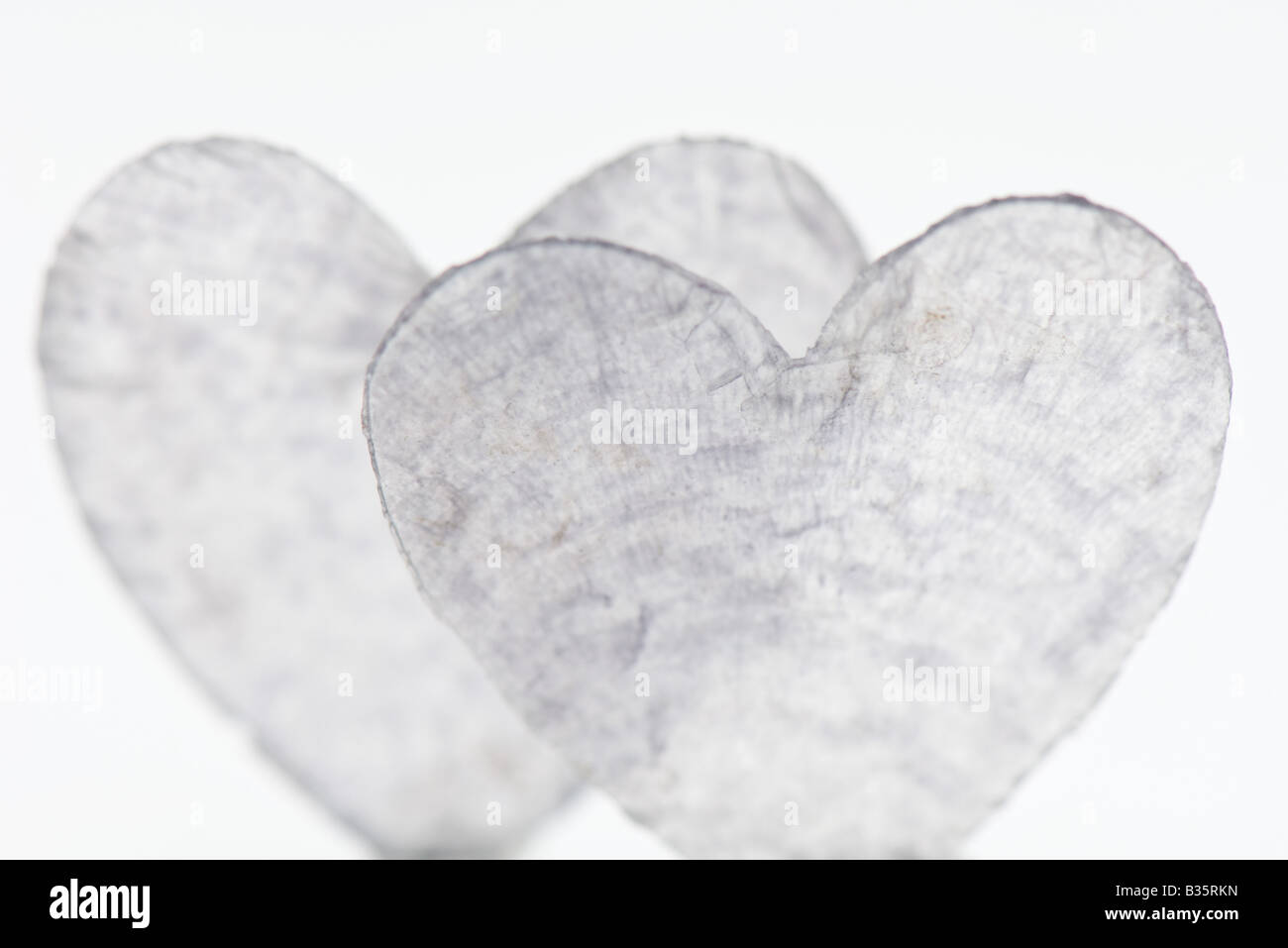 Heart shapes made of glass, heavily scratched - Stock Image