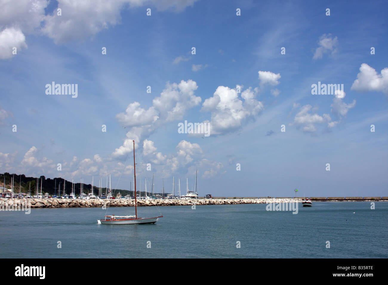 A sailing boat leaving the harbor area at the Maritime Festiville in Port Washington Wisconsin - Stock Image