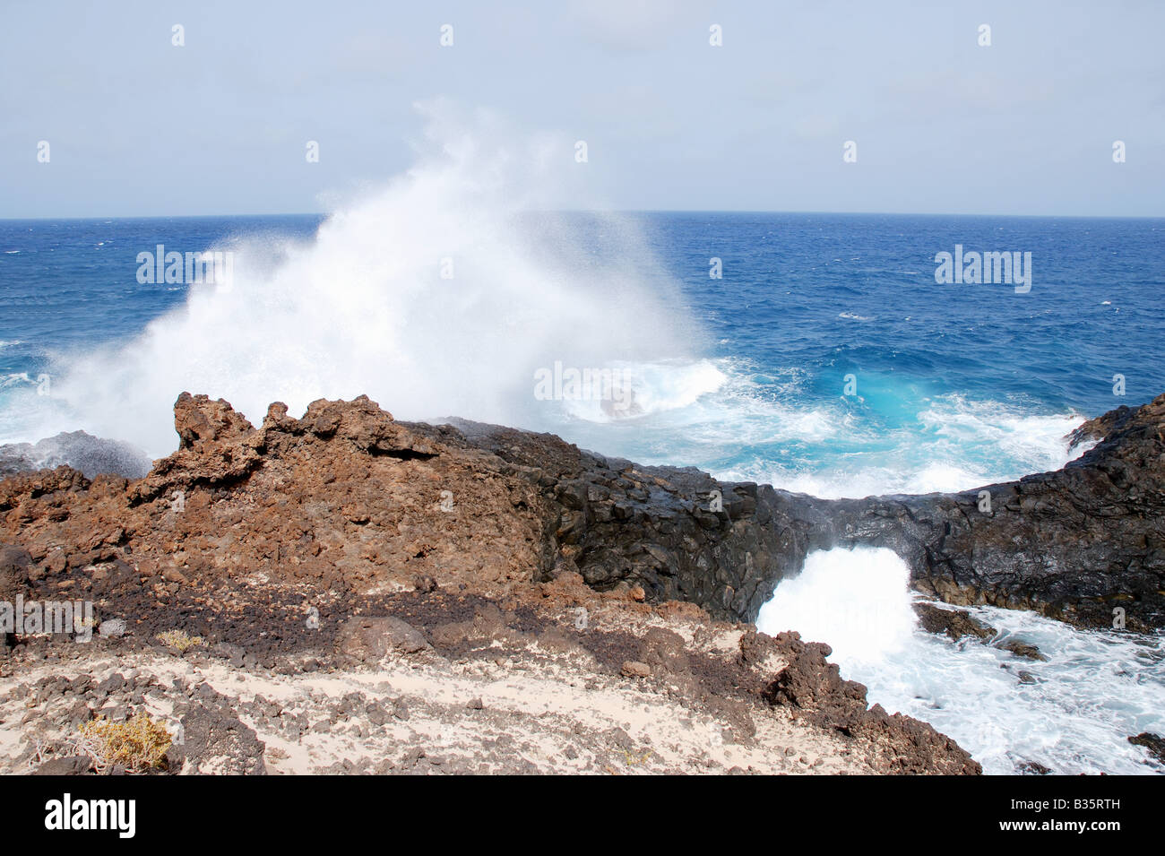 Waves breaking against volcanic rocks. Lanzarote island. Canary Islands. Spain. Stock Photo