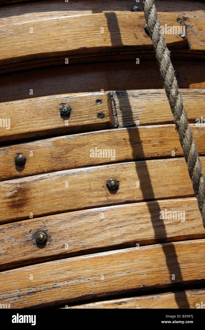 The wooden sail rings on the mast of the Pride of the Baltimore Ship - Stock Image
