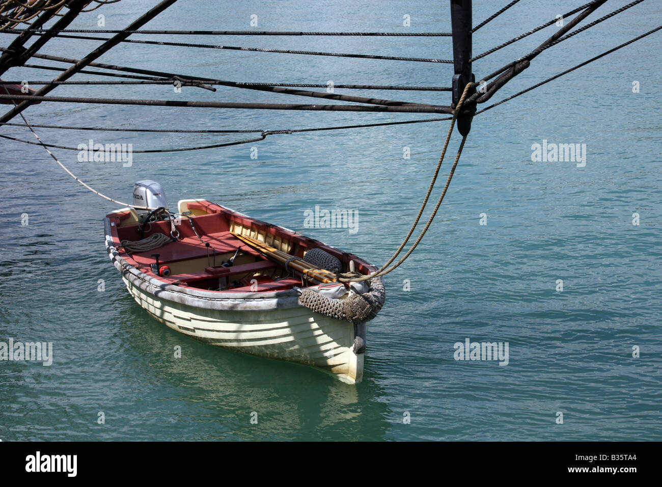 A dingy boat tied up to the US Brig Niagara dock in Port Washington Wisconsin - Stock Image