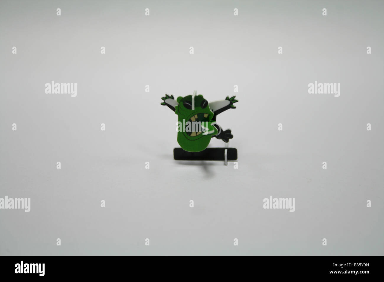 Fancy green colored desk top ghost item toy which can be kept in corporate office for stress relief and creativity - Stock Image