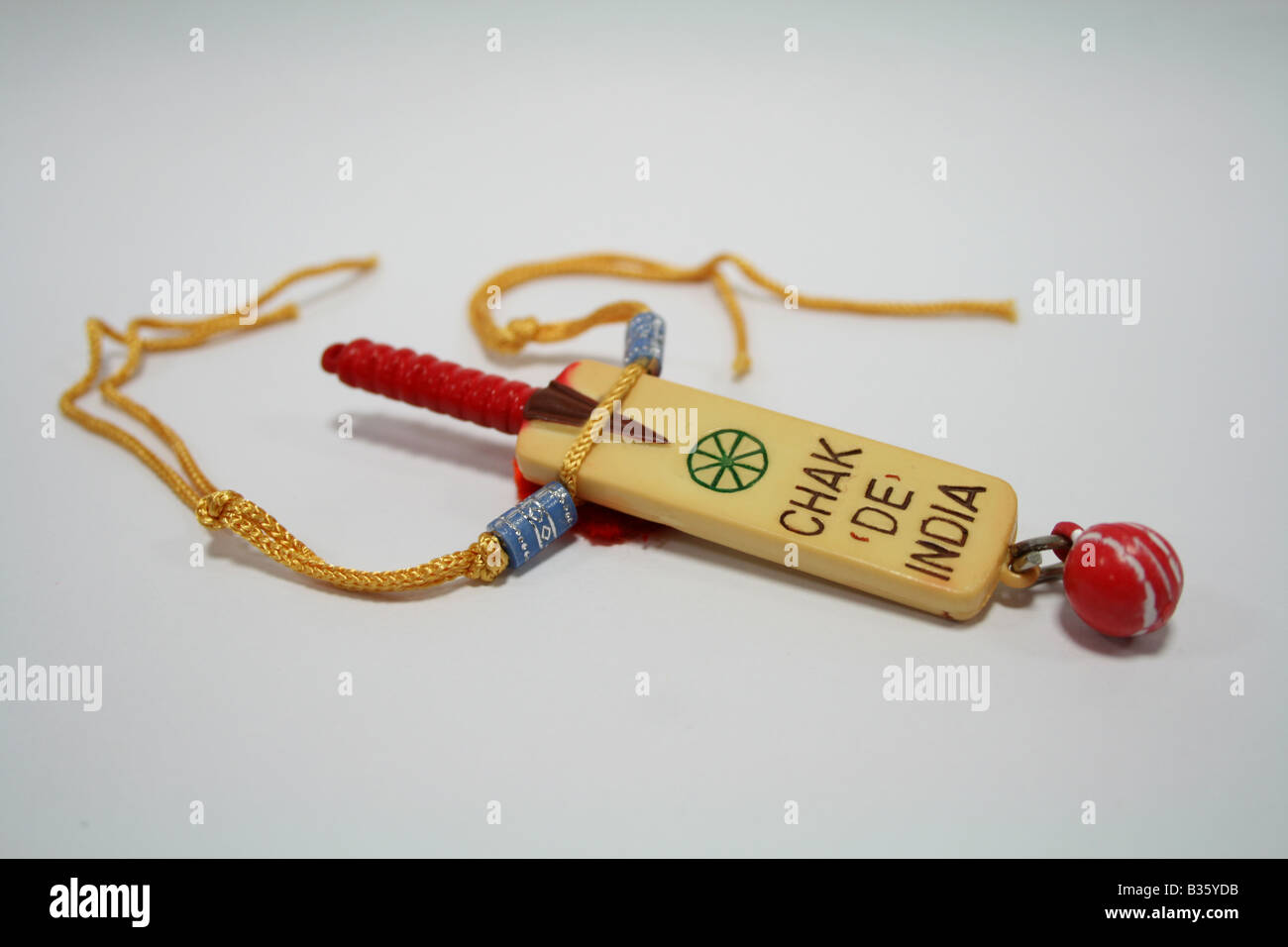 Rakhi or wrist band with Cricket bat and ball theme given by sister to brother during popular Indian festival Raksha Stock Photo