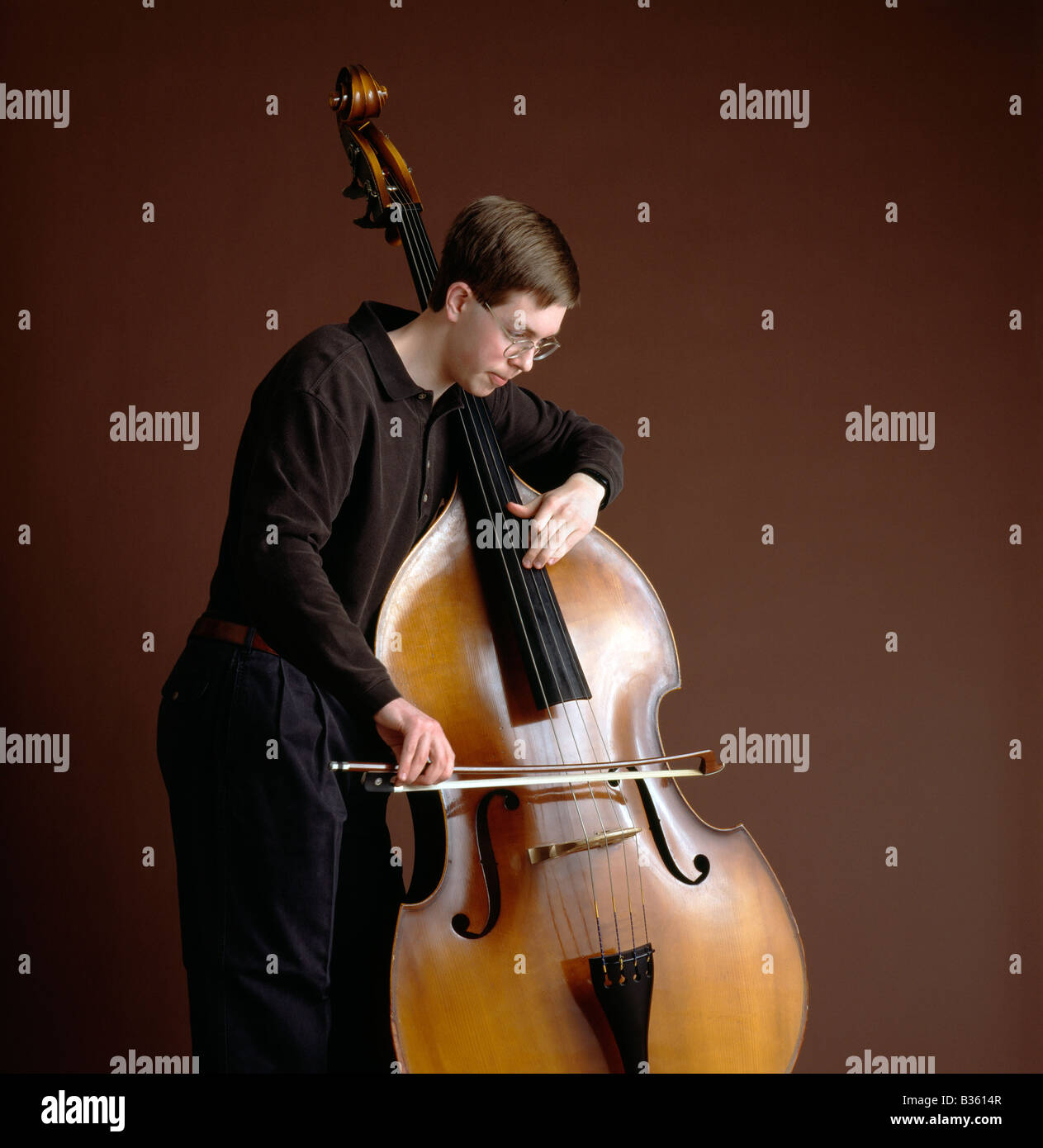 Male high school student playing the bass cello Stock Photo