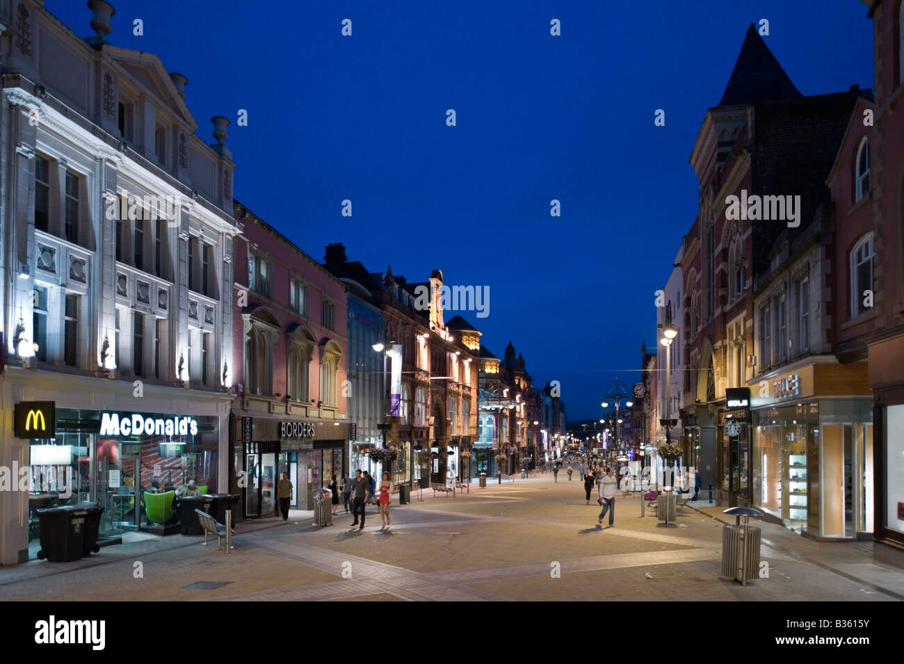 Briggate (the main shopping street) at night in the city centre, Leeds, West Yorkshire, England - Stock Image