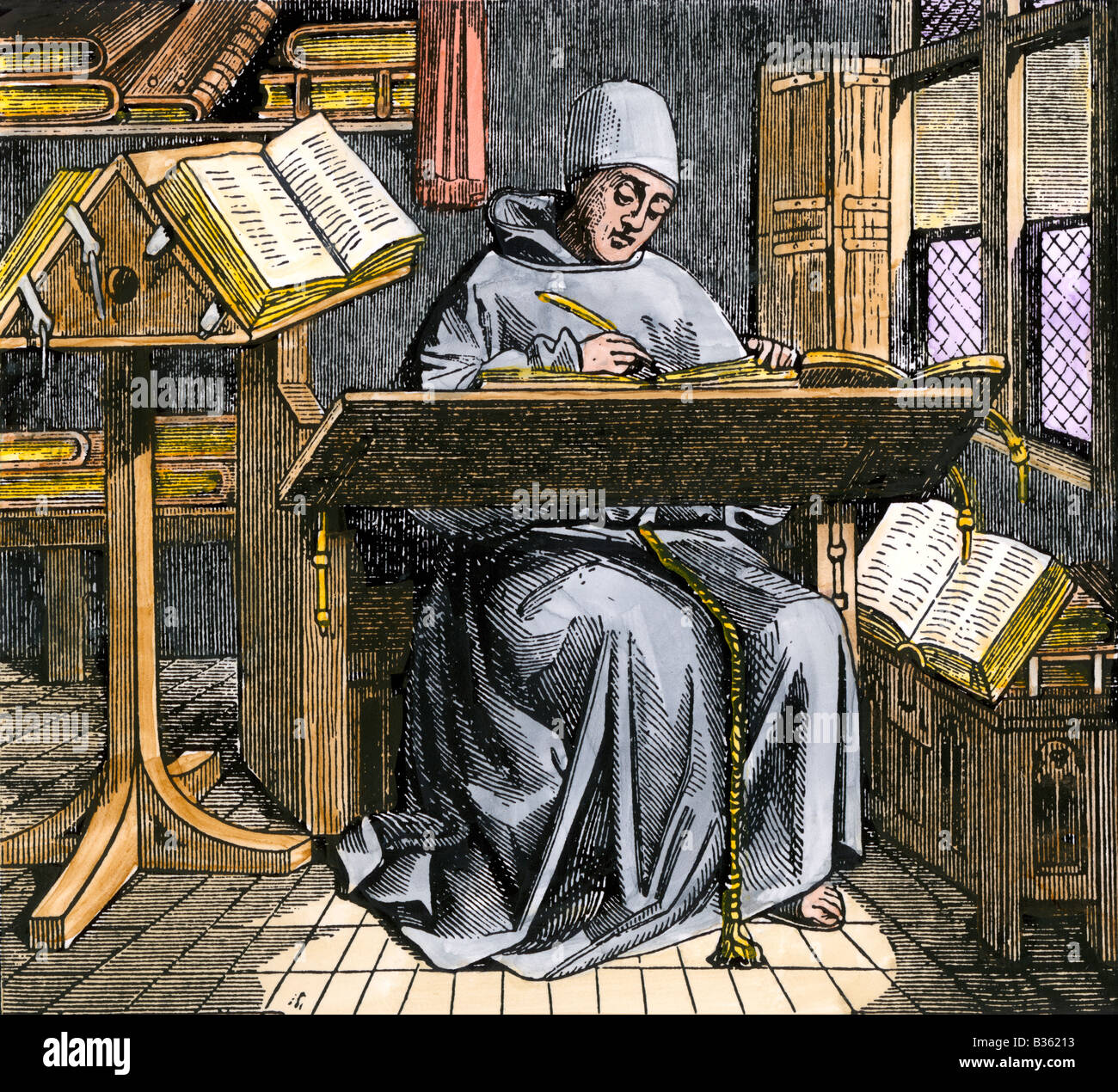 Medieval scribe writing at a desk surrounded by open manuscripts. Hand-colored woodcut - Stock Image