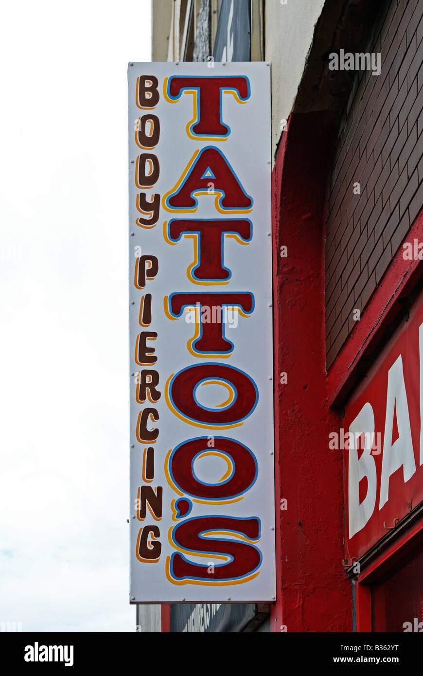a sign advertising a tattooing parlour in blackpool,uk - Stock Image