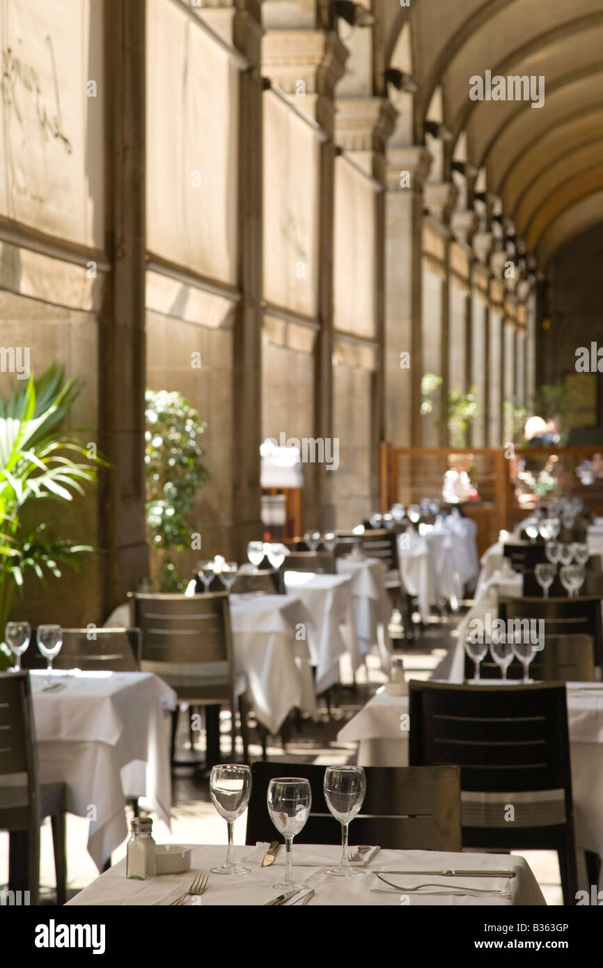 SPAIN Barcelona Empty restaurant tables set in walkway of Placa Reial Neoclassical square plaza - Stock Image