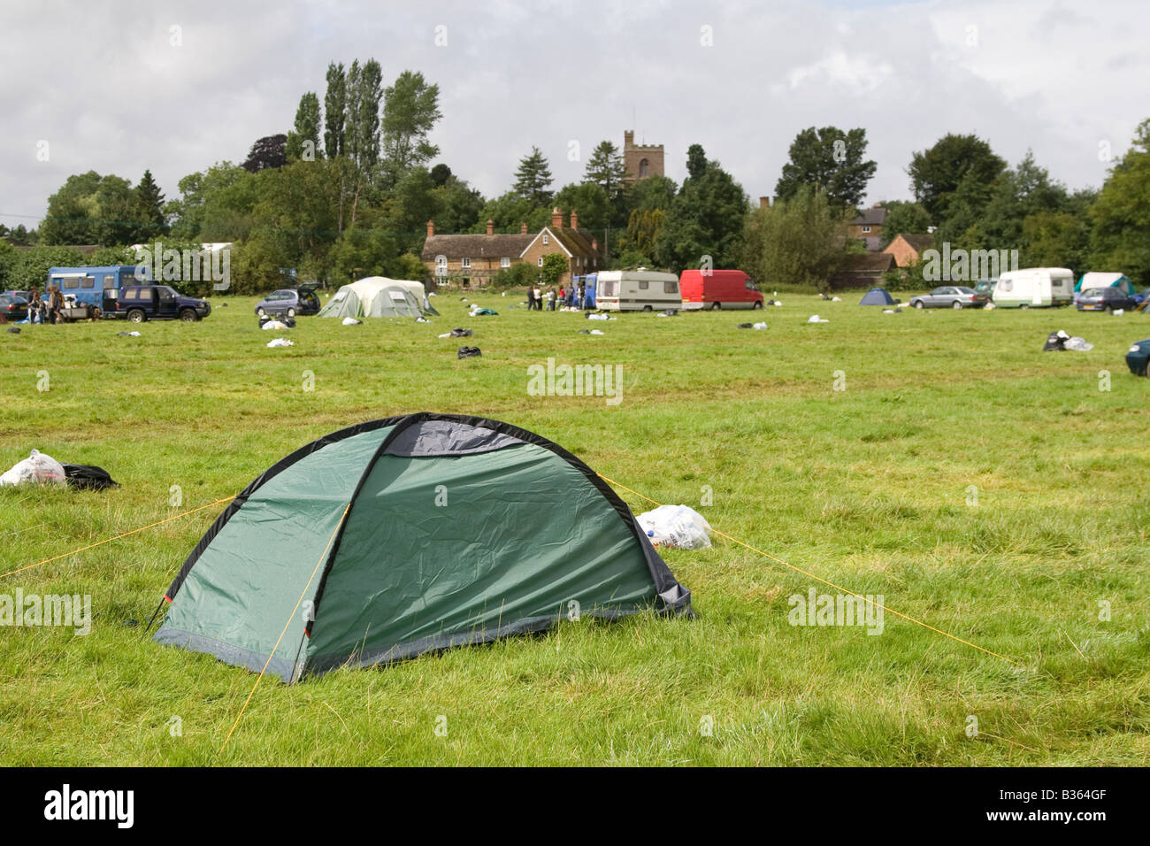 a tent abandoned by music festival goers at the Fairport Cropredy Convention festival - Stock Image