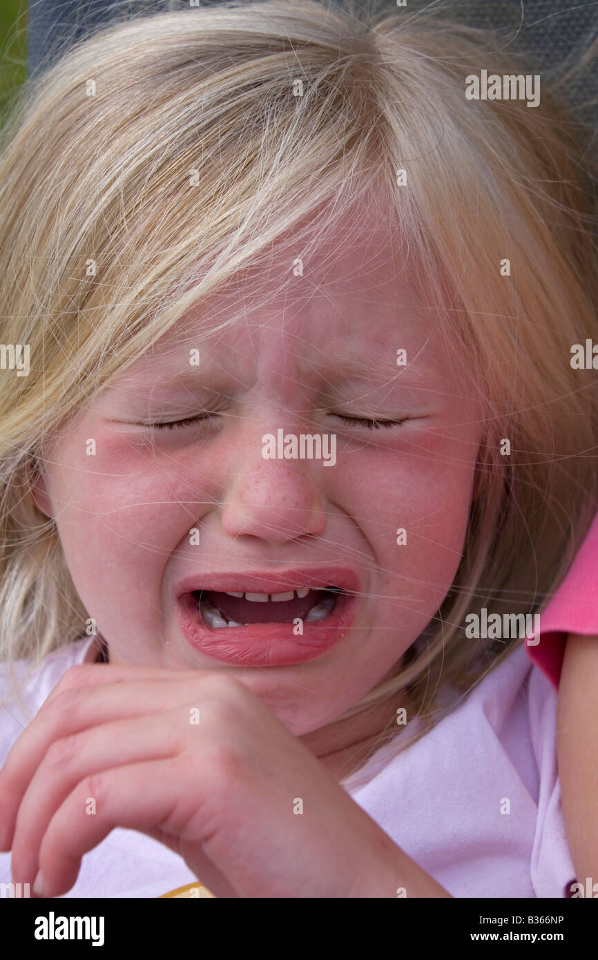 5 year old girl crying close up - Stock Image