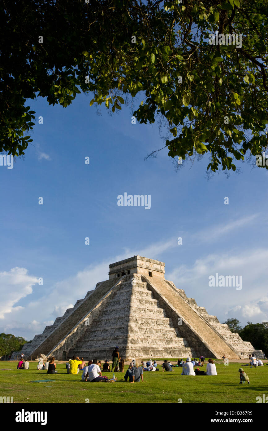Tourists viewing El Castillo Pyramid of Kukulcan 'The Castle' during the fall equinox at the Mayan site - Stock Image