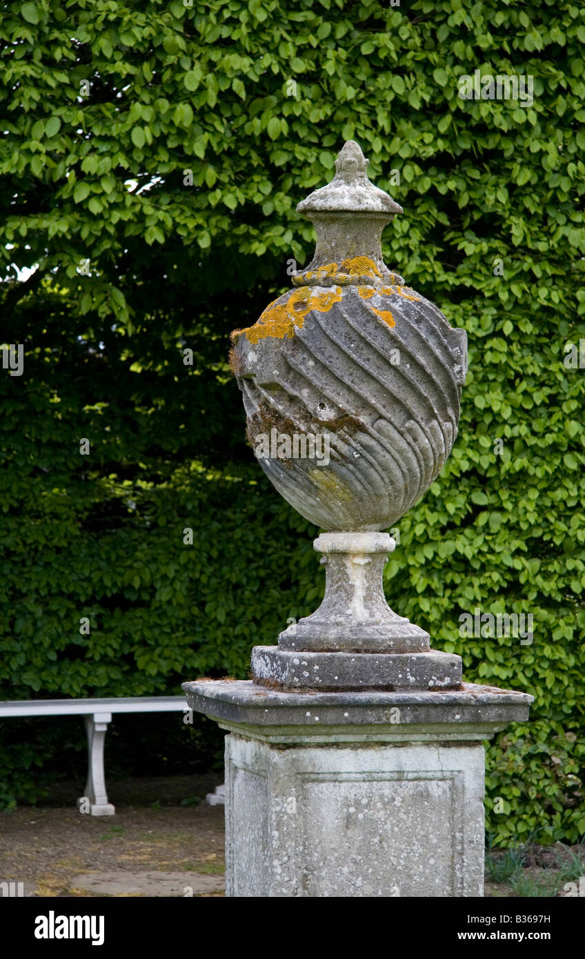 Grecian Urn Garden Ornament Covered In Lichen In The Grounds Of Castle  Howard In Yorkshire.