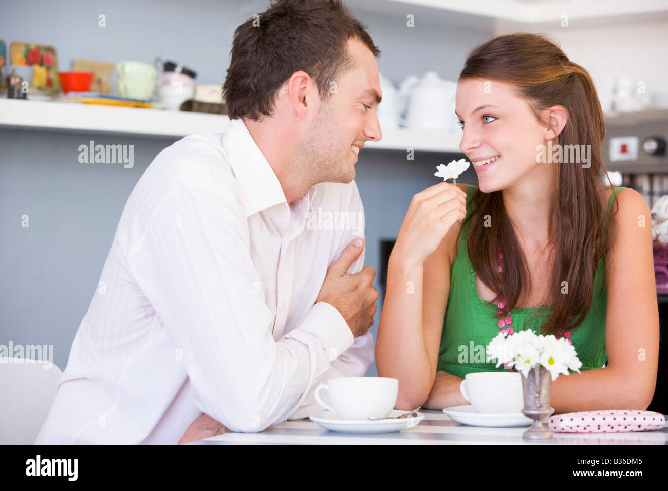 Young couple having tea in a cafeteria - Stock Image
