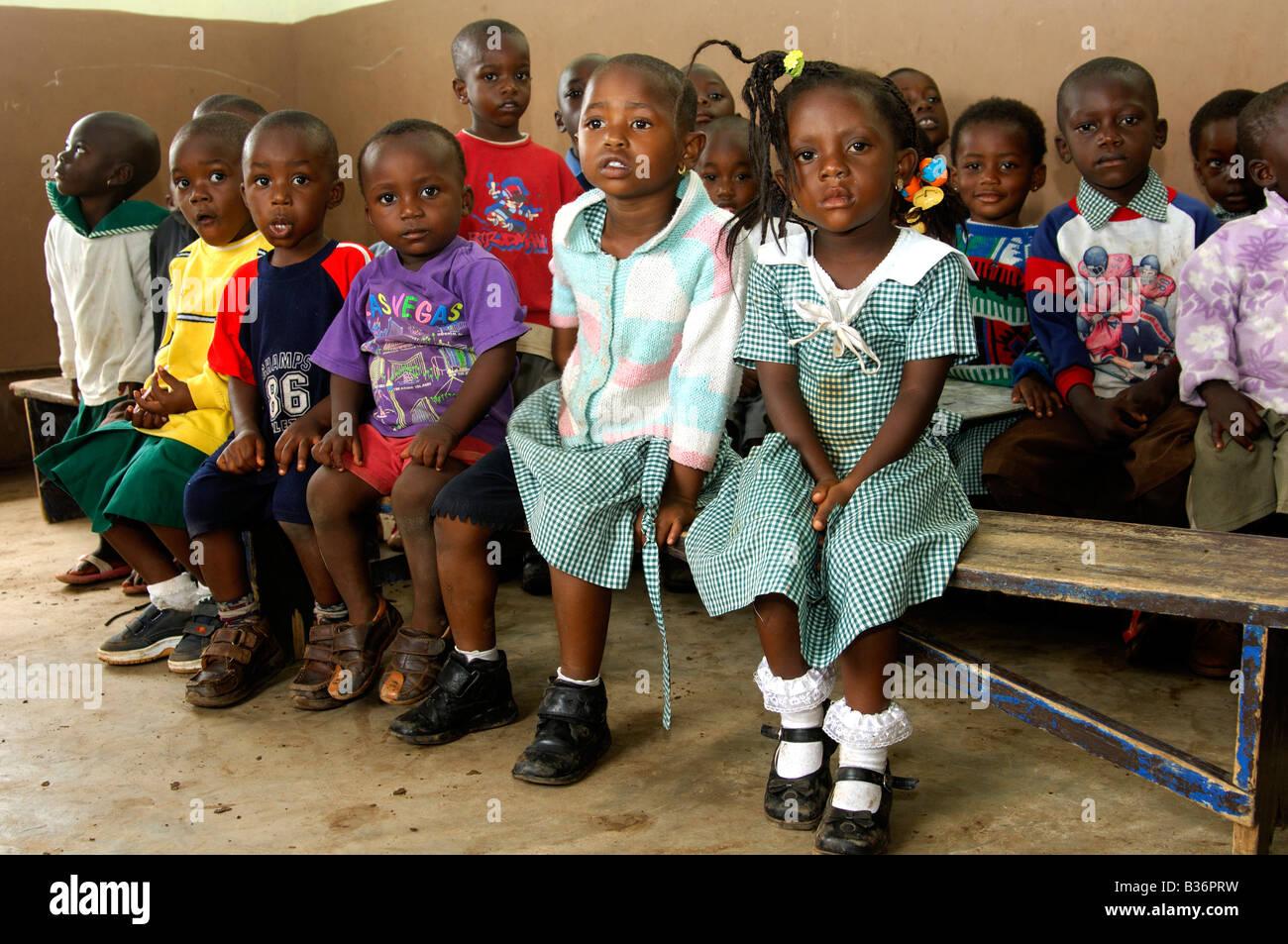 Pre school children in a simple day care centre in Akropong Akwapim Eastern Region Ghana - Stock Image