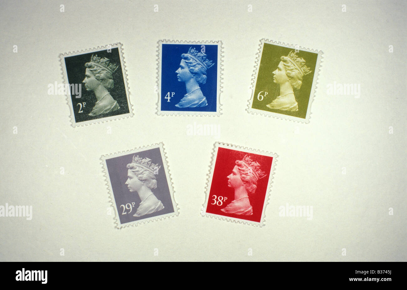 coloured postage stamps illuminated by white light see also B373FA for same stamps in red light - Stock Image