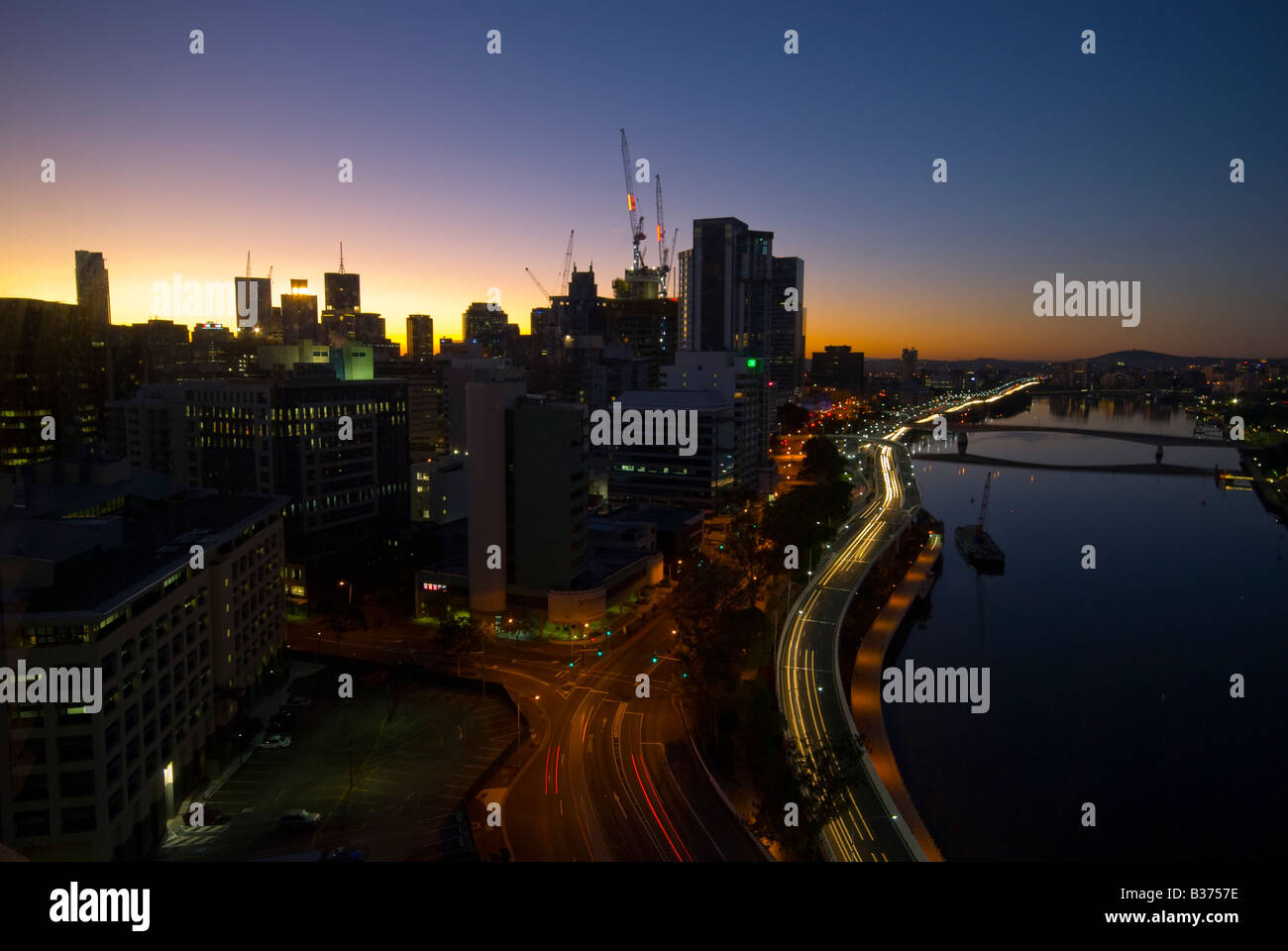 Brisbane city skyline along the Brisbane River at sunrise - Stock Image