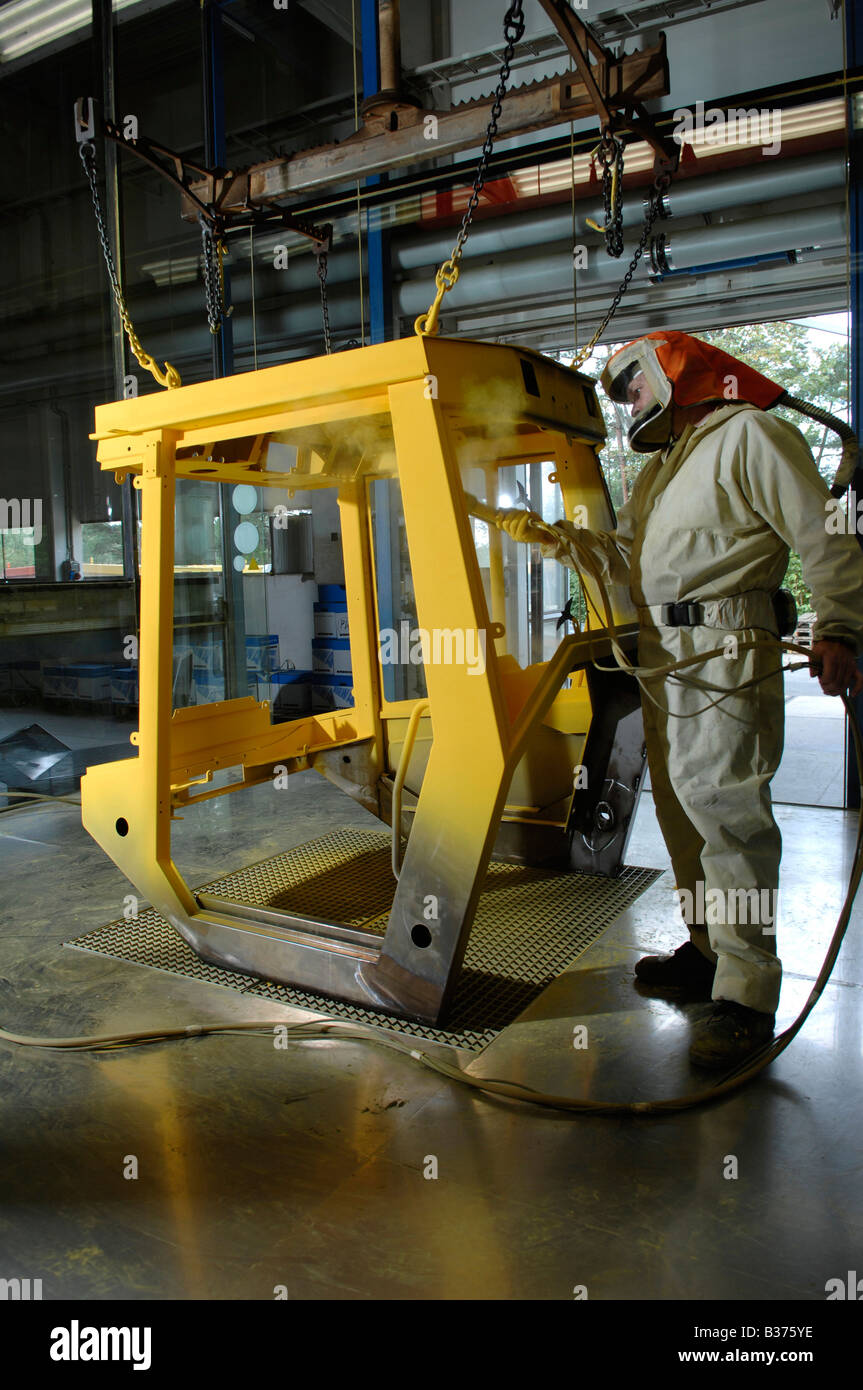 Powder coating of metal surfaces. - Stock Image