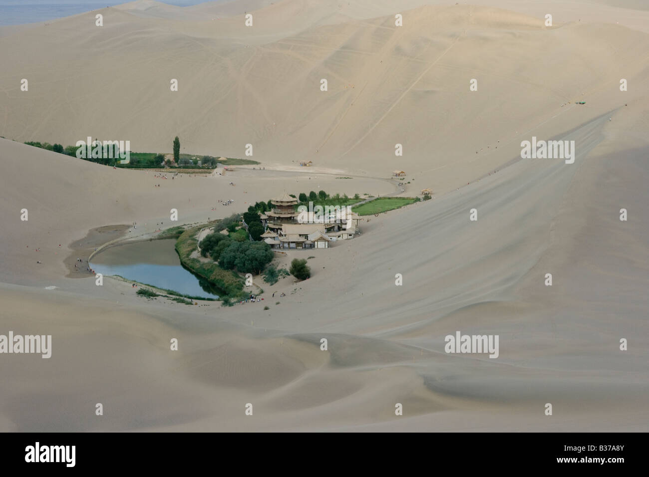 Crecent Moon Lake at Singing Sands Mountain Sand Dunes in Dunhuang China Stock Photo