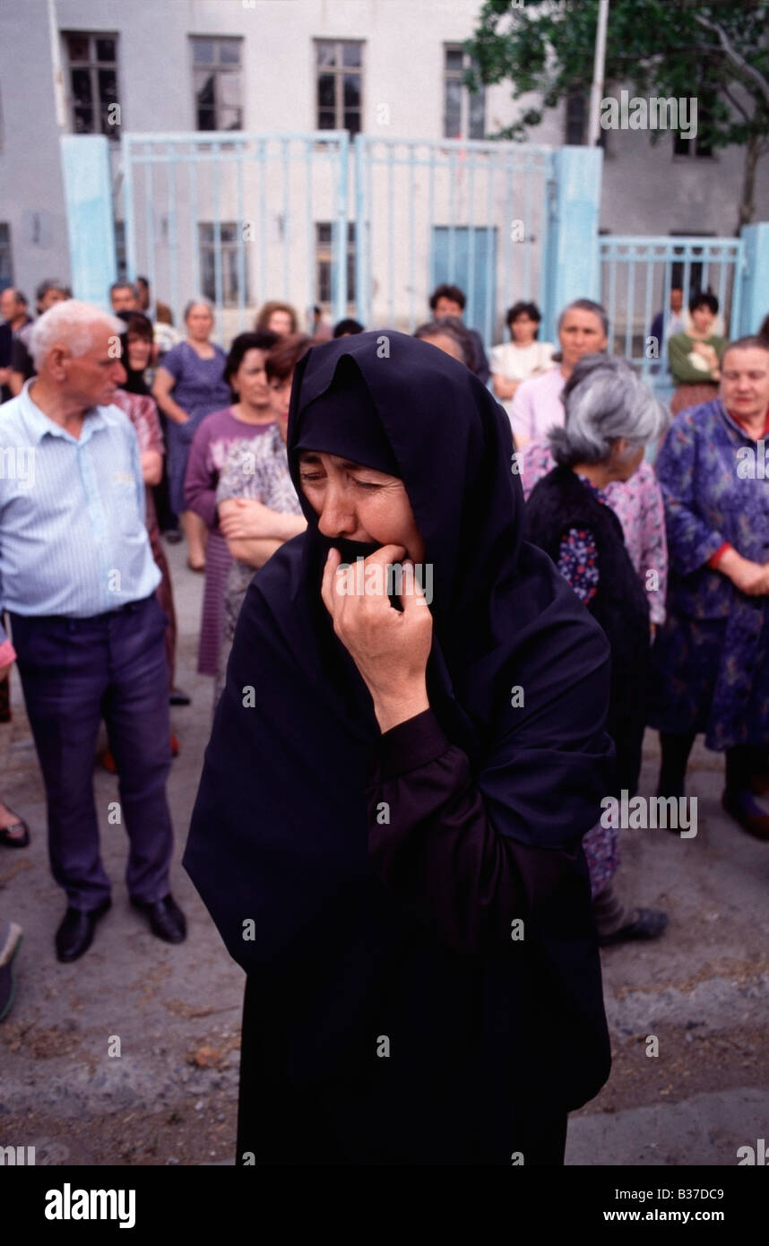 Mother cries in the street for her son who was killed during armed fighting in Tskhinvali, South Ossetia in 1992. - Stock Image