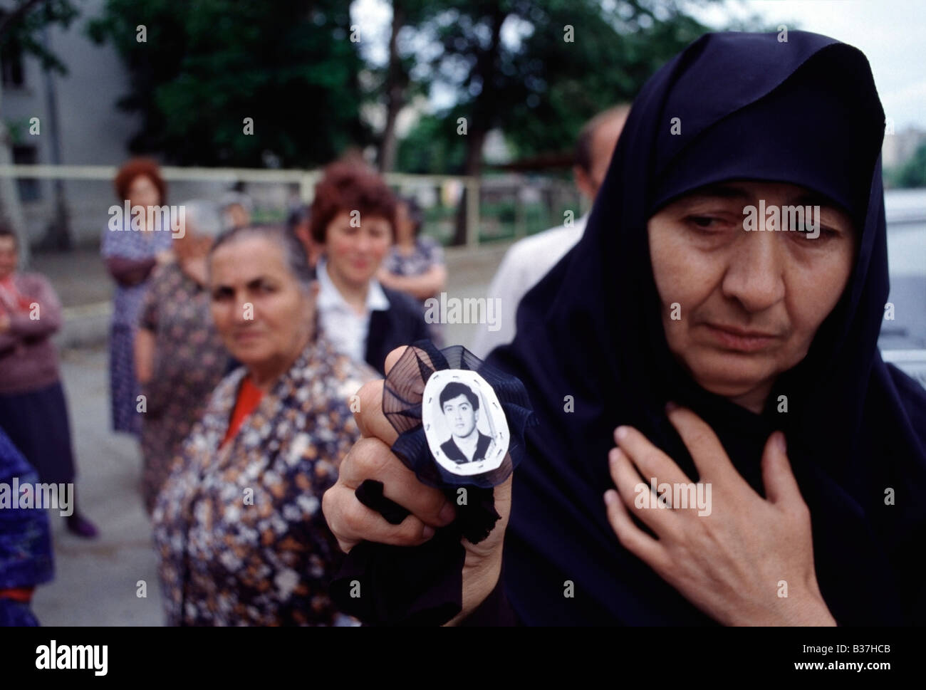 Mother holds a photo of her son who was killed during armed fighting outside of a hospital in Tskhinvali, South - Stock Image