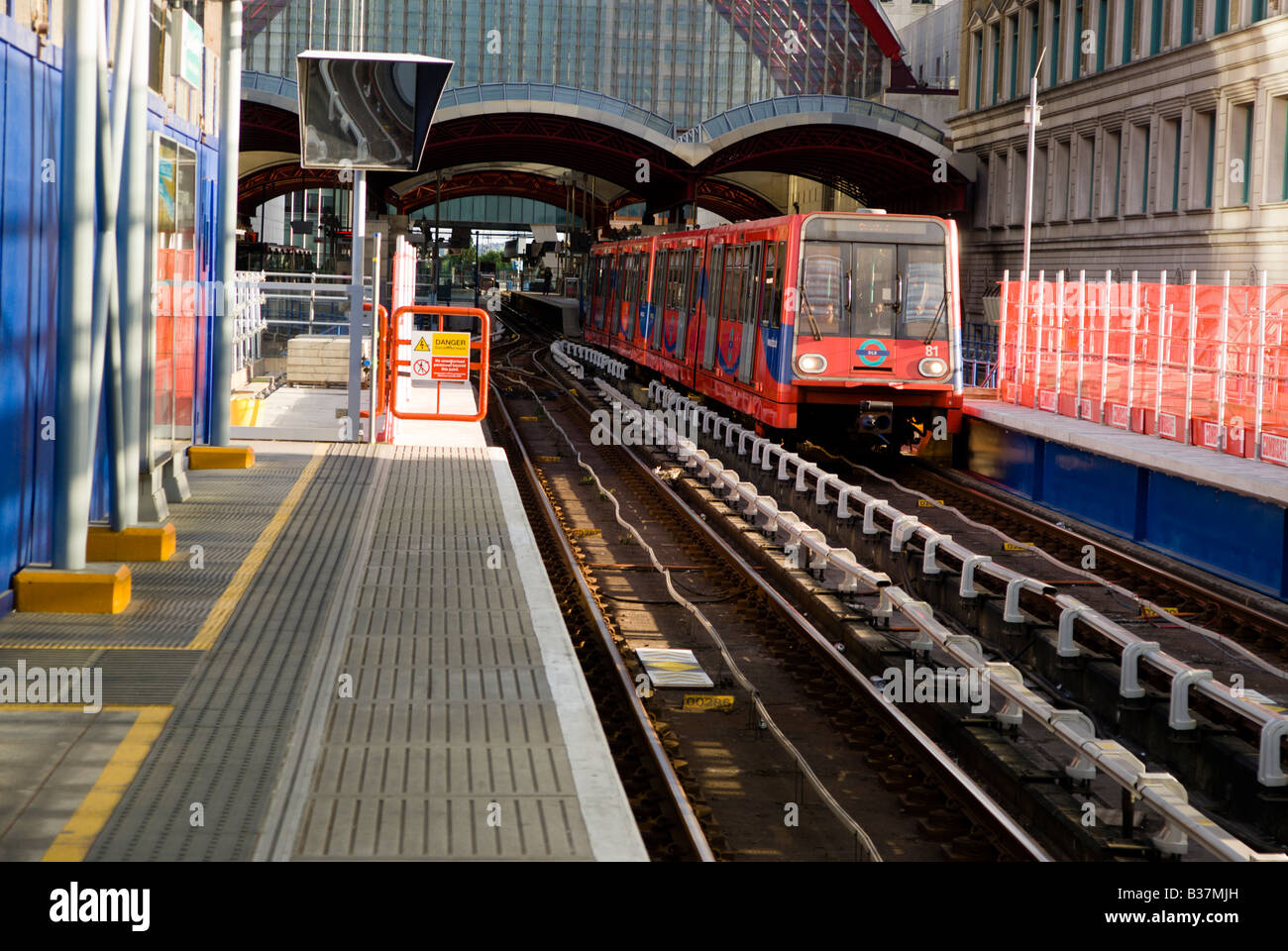 Underground Train arriving at the platform in London. - Stock Image