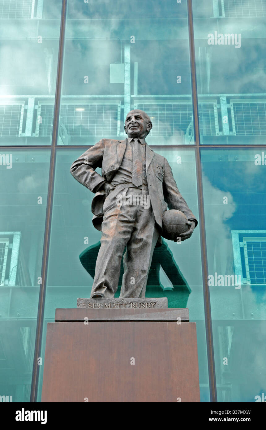 the statue of Sir Matt Busby outside old trafford home of manchester united football club,manchester,england,uk - Stock Image