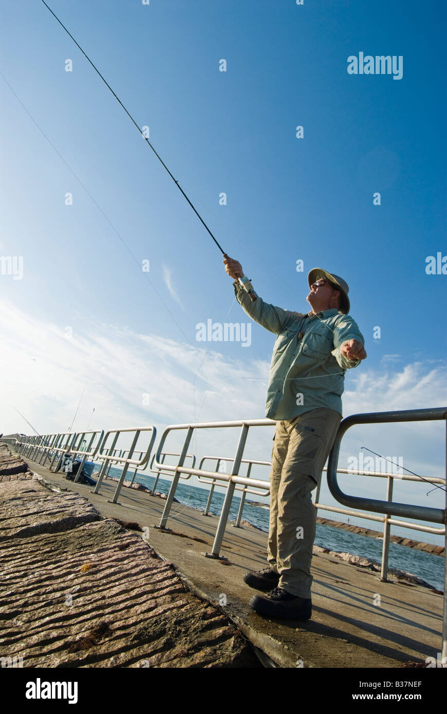 Fly fishing off the Packery Channel jetty on Mustang Island Texas Gulf Coast - Stock Image