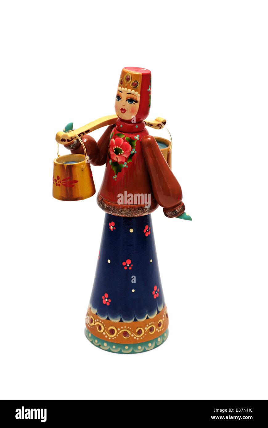 Russian Wood Curved Hand Painted Doll - Stock Image