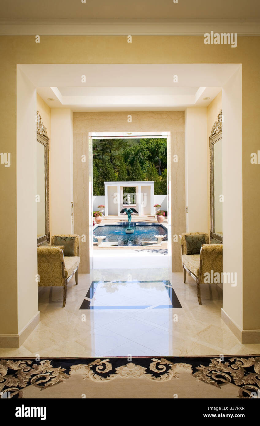 Interior of a marble hallway leading to a pool Stock Photo