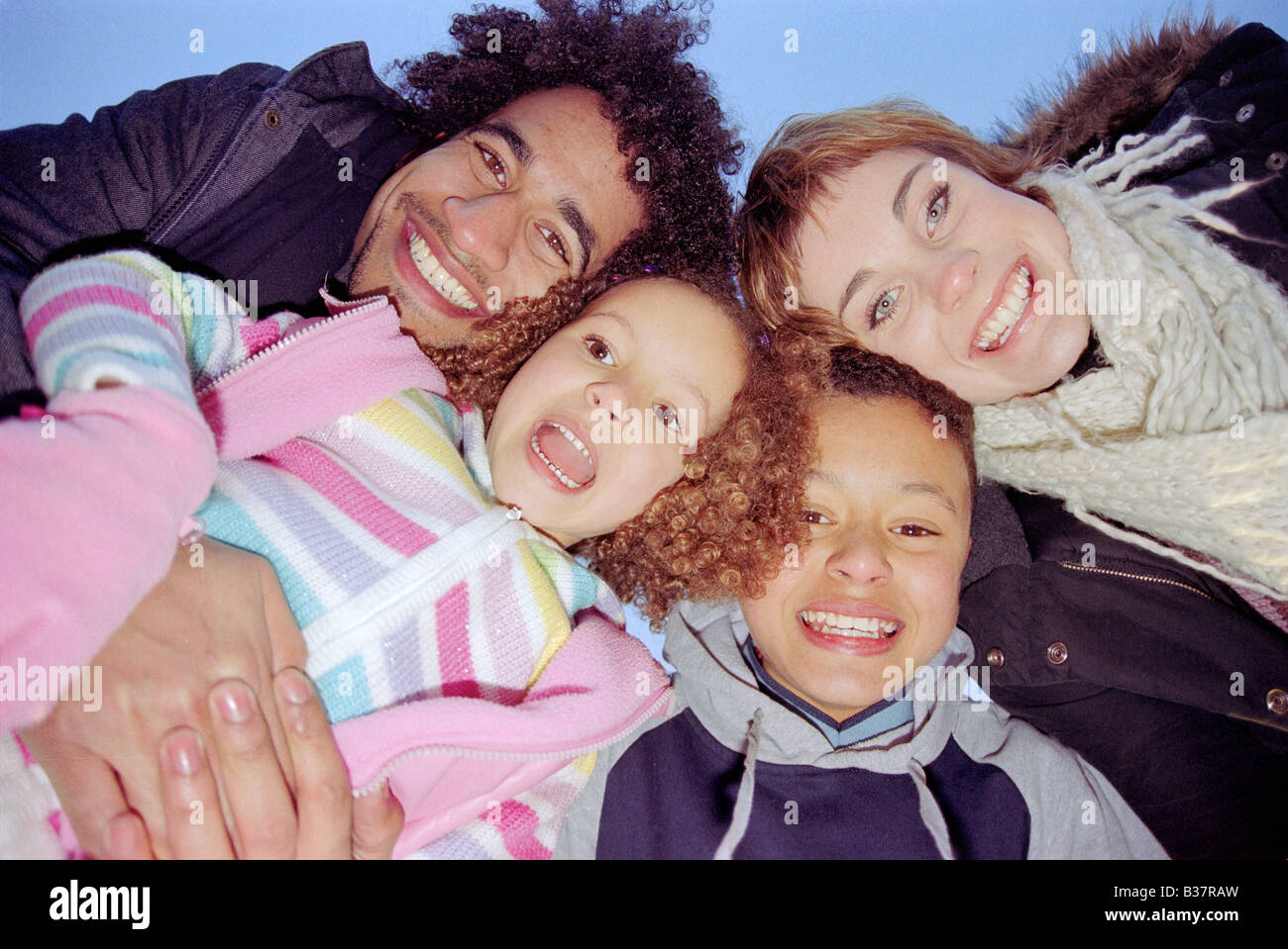 Portrait of young mixed race family taken from unusual angle with wide lens Stock Photo