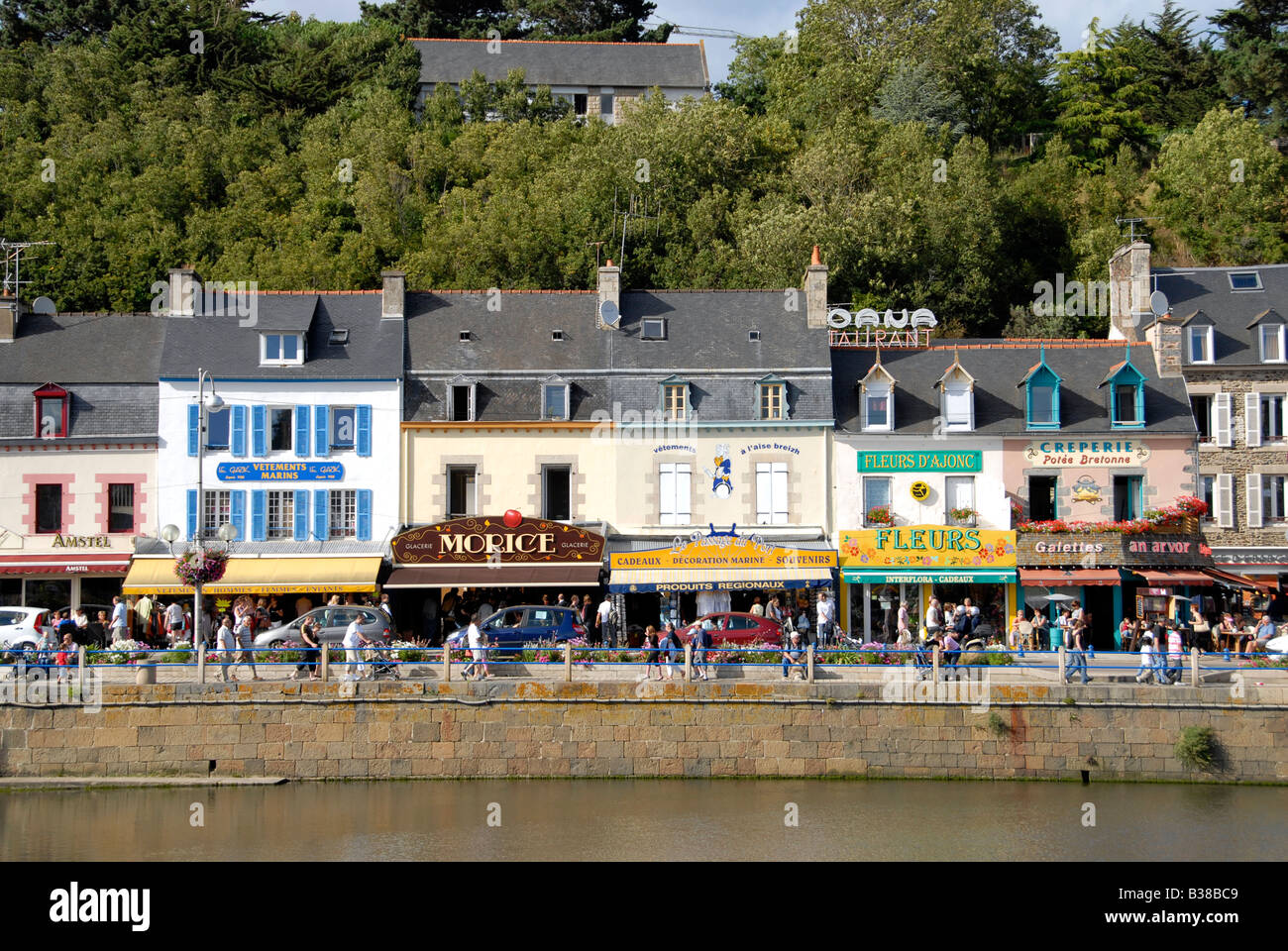 Colourful shop fronts on the harbour front at Binic a popular tourist resort in northern Brittany, France - Stock Image
