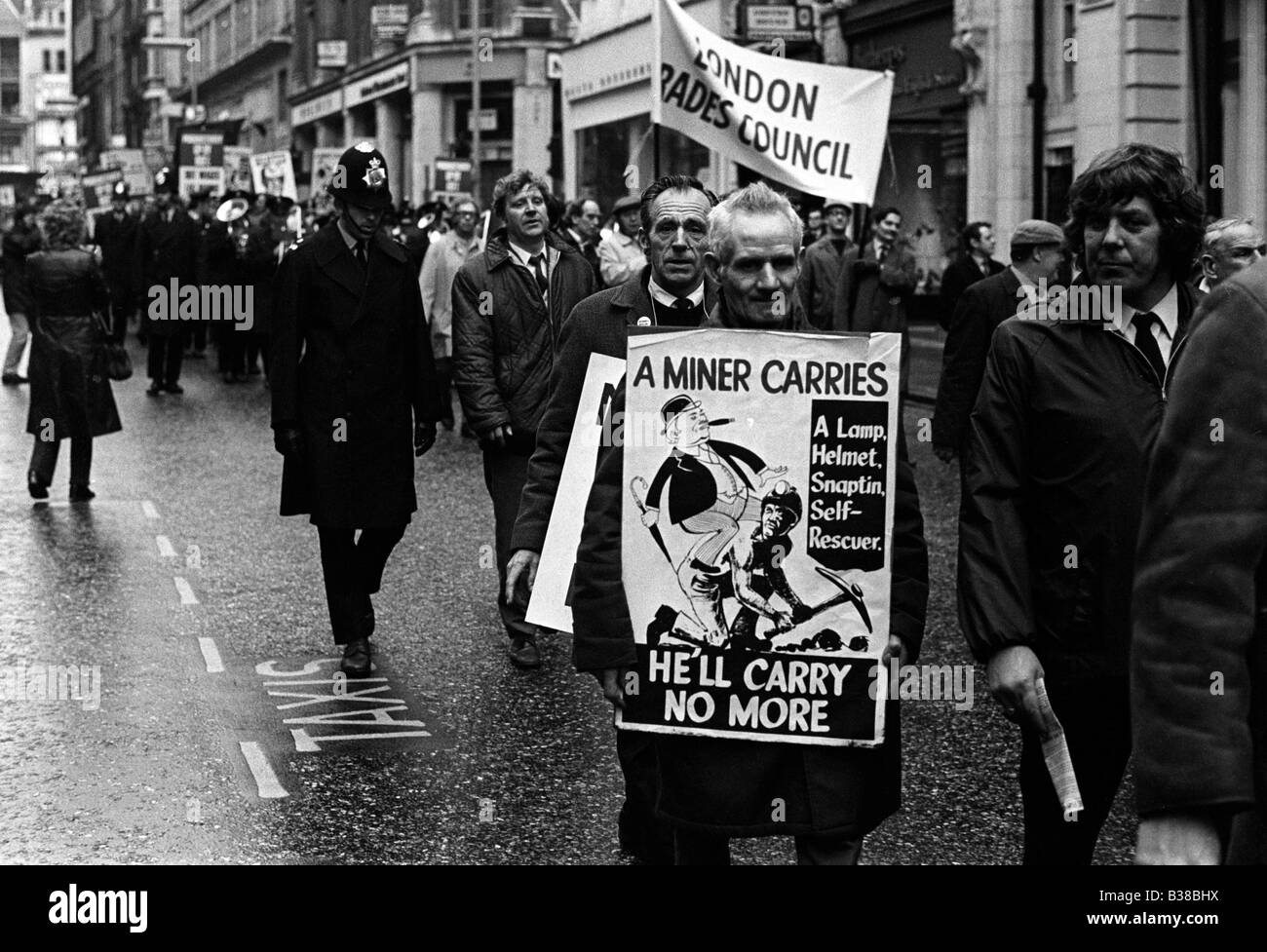 Miners march through central London during the 1972 UK strike - Stock Image
