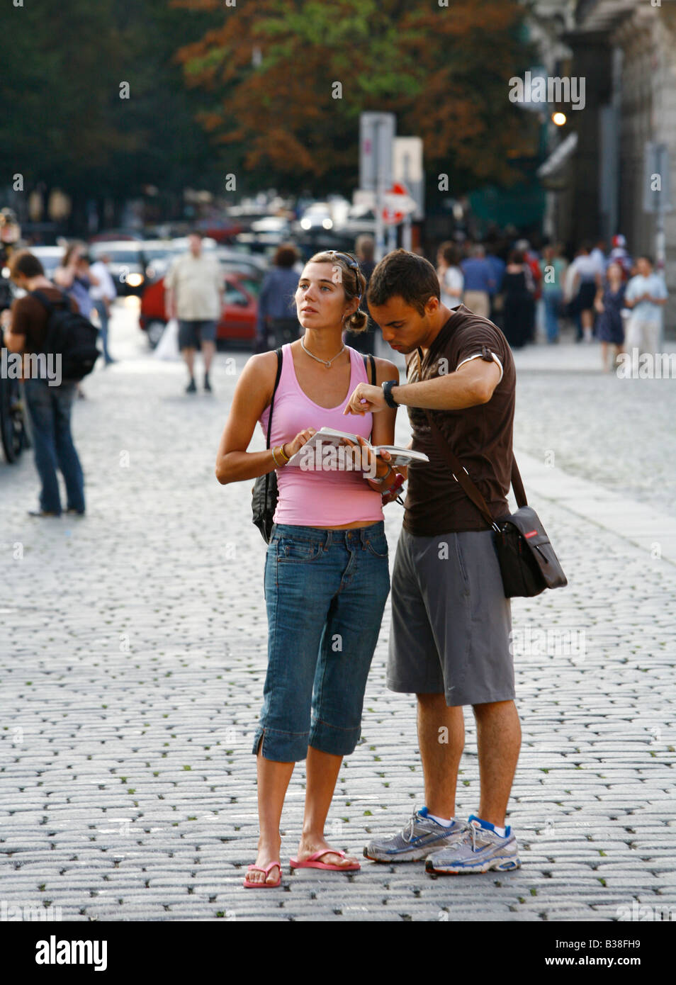 Aug 2008 - Tourist in the Old Town Square looking at a map Prague Czech Republic - Stock Image