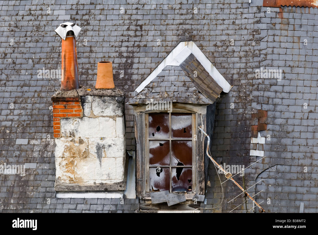 Old chimney stack and dormer window - Loches, France. - Stock Image