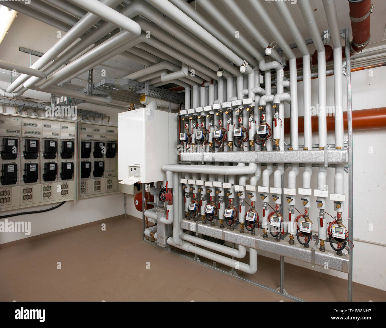 modern heating system with pipes in a apartment building electric ...