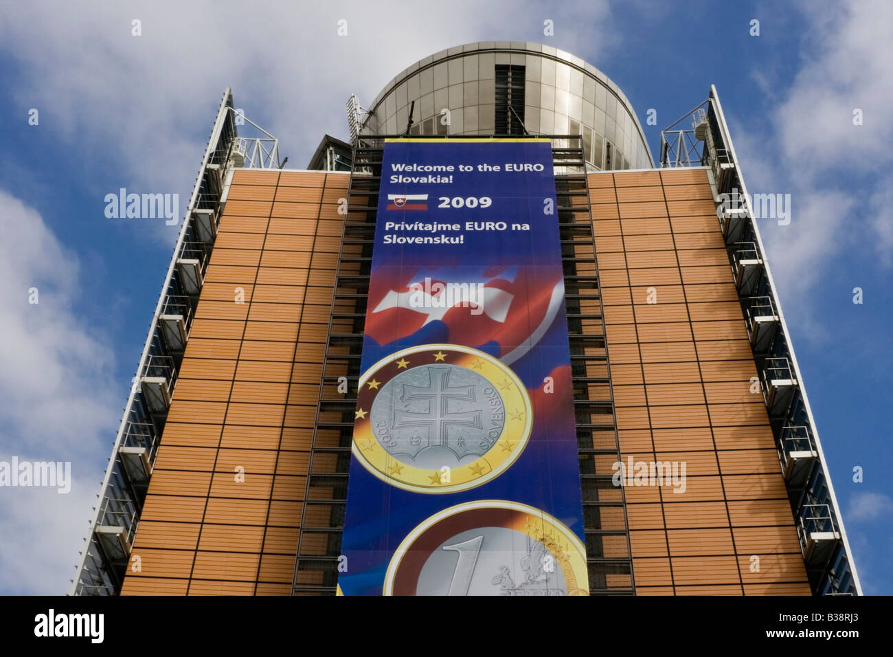 A banner on the side of the Berlaymont building in Brussels, Belgium, welcomes Slovakia to the Eurozone. - Stock Image
