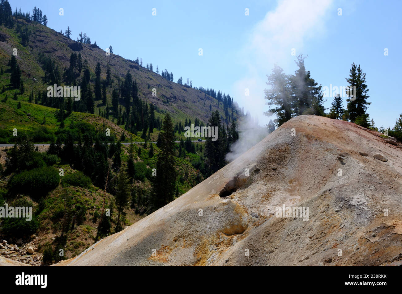 Steam vent and deposits from volcanic activity. Lassen Volcanic National Park, California, USA. - Stock Image
