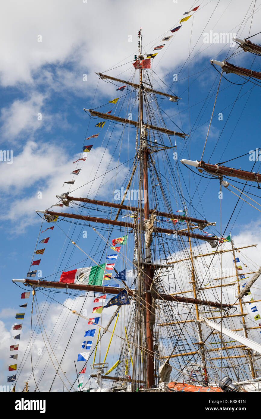 Square rigged masts flying colourful flags on boats in Tall Ships race 2008 Liverpool Merseyside England UK - Stock Image