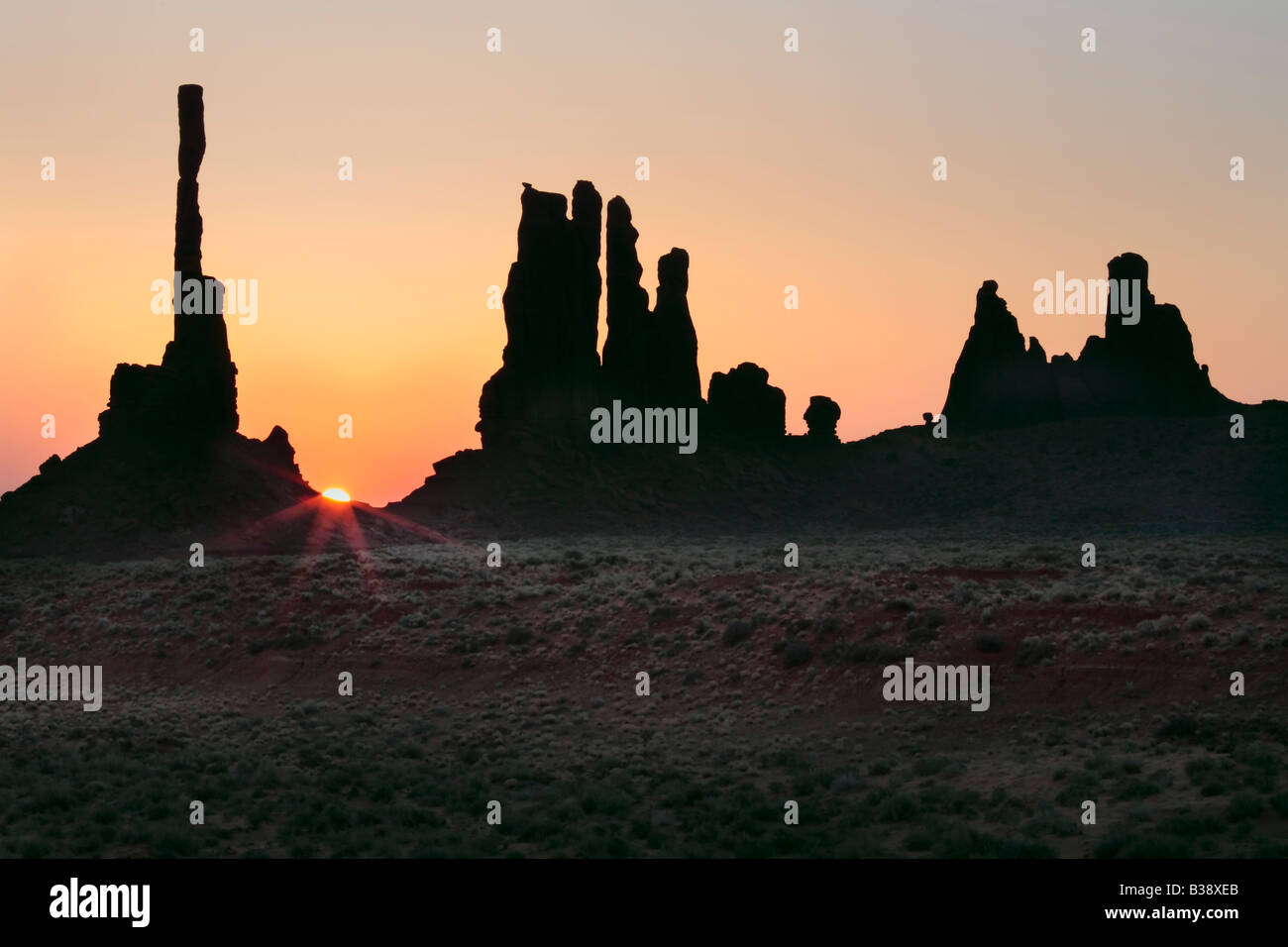 First light at Yei bi Chai rocks in Monument Valley - Stock Image